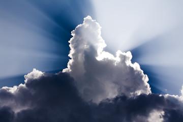 Sun Rays shine through a large cloud