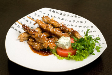 japanese oriental food on white dish, teriyaki