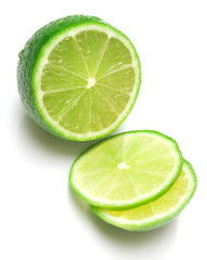 The tropical fruit known as lime, cut across. isolated on white.
