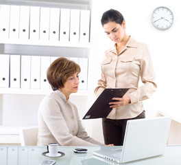 Senior businesswoman and assistant working in the office.