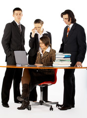 business team with laptop and books near the table