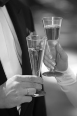 two glasses of champagne in hands