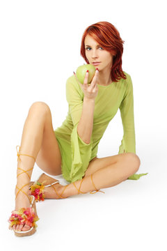 sexy redhead girl with green aple