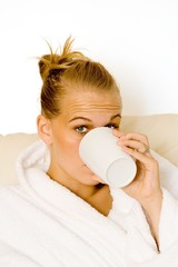 woman drinking mug or cup of hot coffee drink