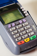 Close-up of card machine isolated over white background