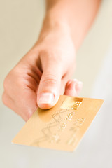 Close-up of female's hand holding credit card