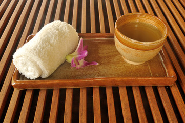 Cup of oriental tea served before massage