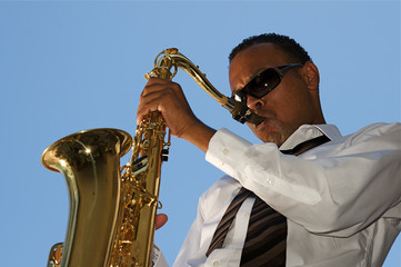 An youung and trendy African-American sax musician