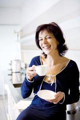 smiling woman with coffee