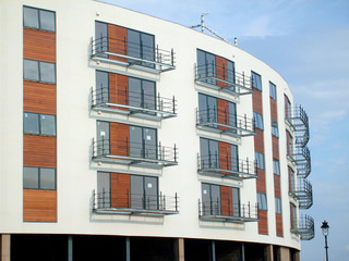 Exterior facade of modern new apartment building facade.