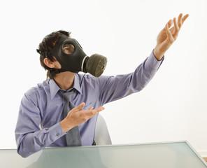 Man wearing gas mask gesturing.