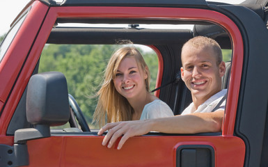 Couple in Red Jeep