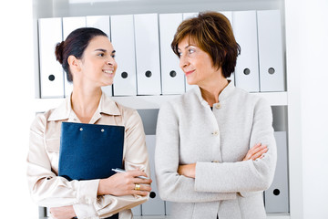 Portrait of a senior businesswoman with assistant in office