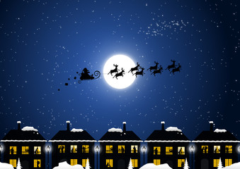 Santa Claus in the Christmas night and happy families