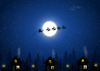 Santa Claus in the Christmas night and houses