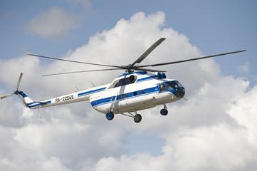 The civil passenger helicopter mi-8 in flight