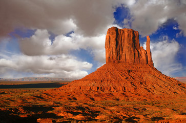 Butte at Sunset in Monument Valley Utah With Cloudy Sky