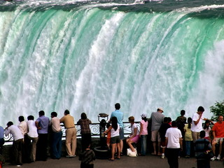 People on falling water background. Niagara Falls
