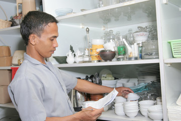 storekeeper inventory in kitchen ware store