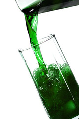 green refreshener drink in a glass with ice blocks