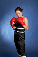 Sexy woman with an attitude and a pair of boxing gloves