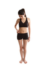 An isolated shot of a healthy asian girl measuring her body fat