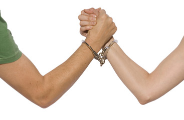 male and female arms with handcuffs in white background