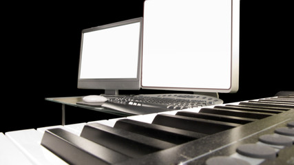 a computer music workstation and keyboard