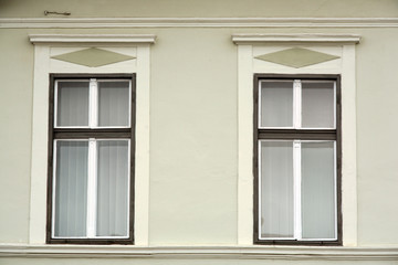 two romanian classic windows on painted wall