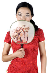 Chinese female model, covering face with small fan