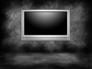 Silver Plasma Television Hanging on an Interior Wall