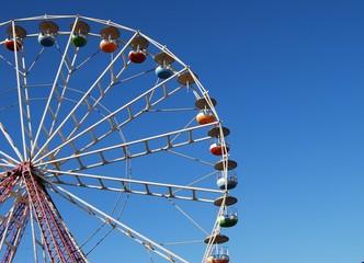 Ferris wheel on background blue sky