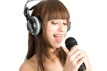 Woman in headphones Singing into Microphone