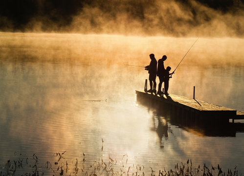 Early morning fishing in autumn on a lake