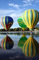 Three balloons on lake
