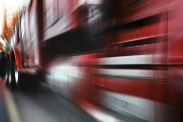 photo of moving red truck with motion blur