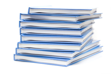 stack of books with blue covers isolated on white