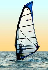 Windsurfer on waves of a sea