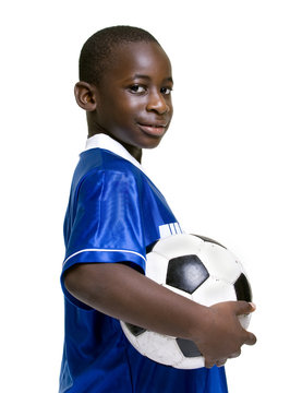 A young preteen with his favorite thing... Soccer