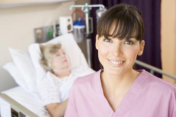 Nurse Standing In Hospital Room,Smiling