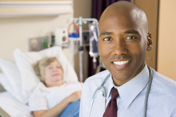 Doctor Smiling,Standing In Hospital Room