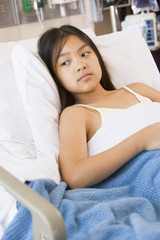 Young Girl Lying In Hospital Bed