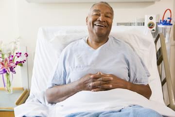 Senior Man Sitting In Hospital Bed,Smiling