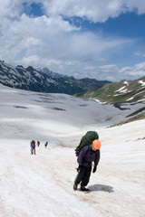 all-in alpinist ascenting on glacier in caucasus mountain