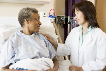 Doctor Talking To Senior Woman