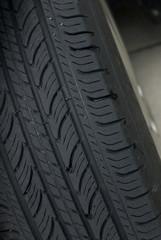 Closeup of a black car tire's tread