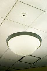 Photo of white lamp hanging from ceiling