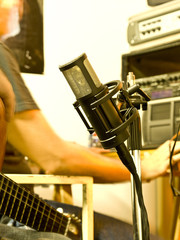 Guitarrist recording with a modern microphone