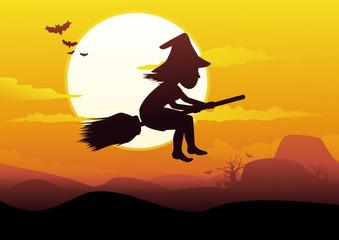 Ombre de sorcière dans le ciel orange
