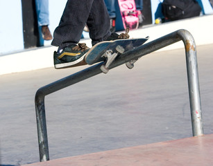 Skateboarder on a fence railing